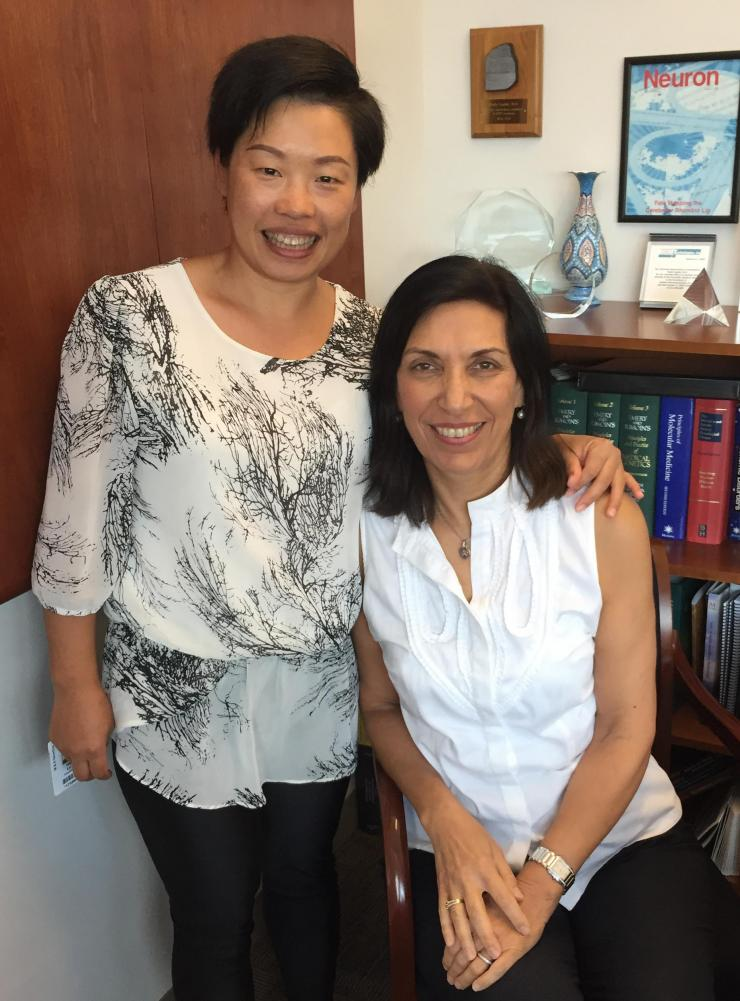 Dr. Hui Lu and her mentor, Dr. Huda Zoghbi