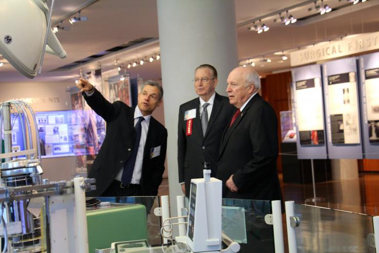 At the Alumni Symposium & 20th Congress of the Michael E. DeBakey International Surgical Society, former Vice President Dick Cheney (right) gets a tour from Dr. Todd K. Rosengart and Dr. Kenneth L. Mattox.