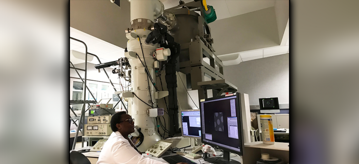 Researcher working at an electron microscope at CryoEM, one of the Advanced Technology Cores at Baylor College of Medicine.