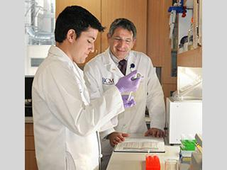 Dr. Paul Klotman with a colleague in the laboratory