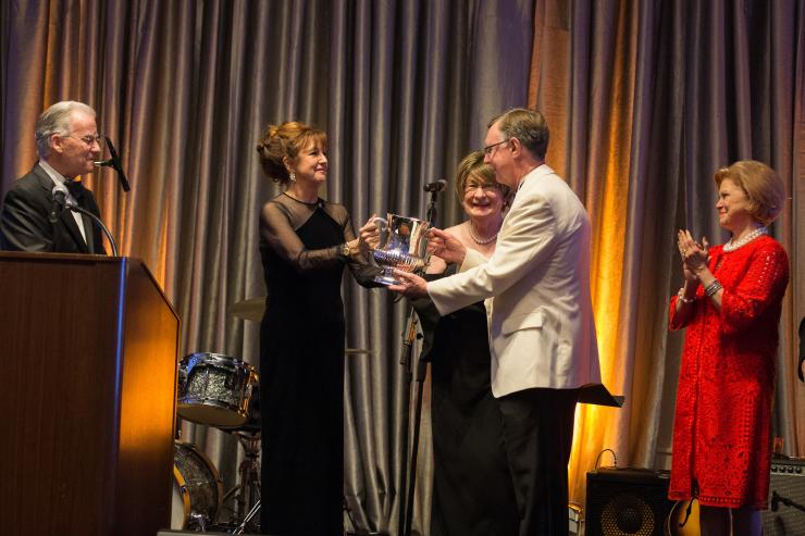 Peggy Carrington, Cora Sue Mach honor Dan L Duncan Comprehensive Cancer Center Director Dr. Kent Osborne during the Café Society Soiree.