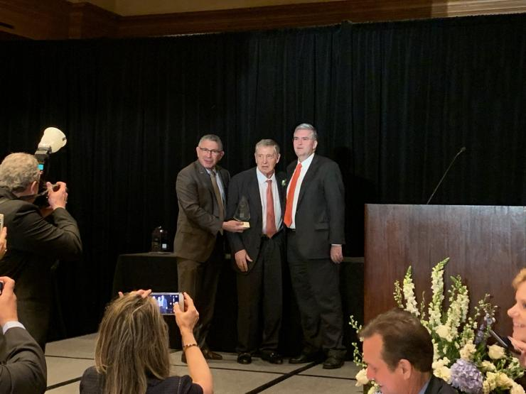 Dr. George P. Noon (center) is presented with the Distinguished Service Award.