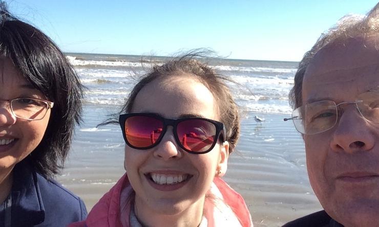 Qian Liu, Justyna Karolak and Prem Szafranski relaxing on the Galveston Beach after the 2019 department retreat.