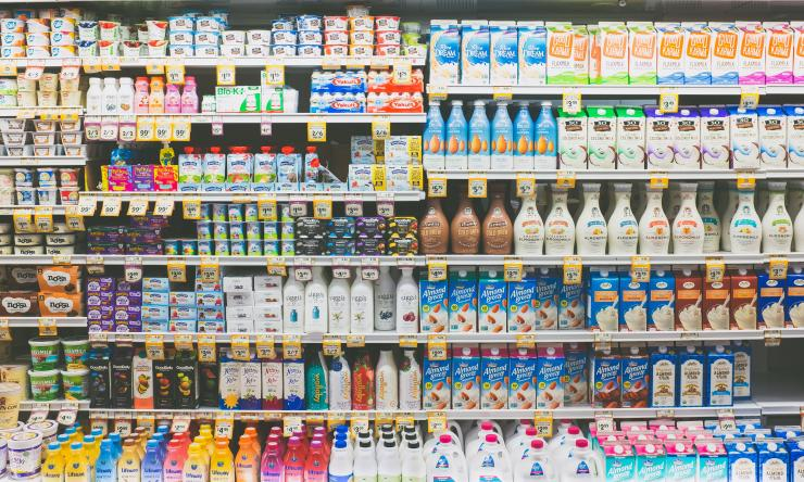 Shelves full of perishable products in a grocery store.
