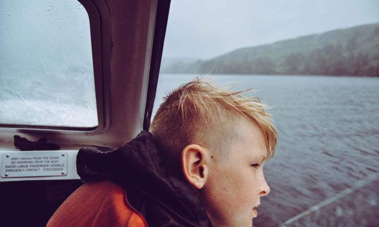 A child looking out across a body of water