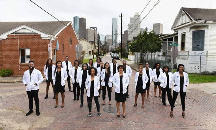 """Joint Black History Month Event  BCM and McGovern SNMA members stand in solidarity at historic bricks in Houston Freedman's Town."""""""