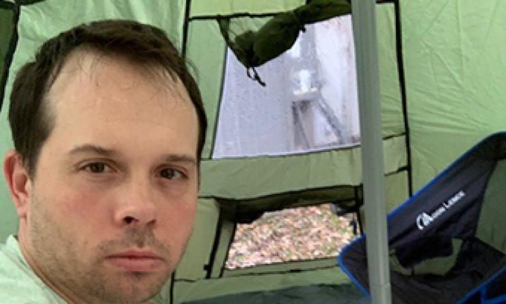 Dr. Brann quarantines in backyard tent