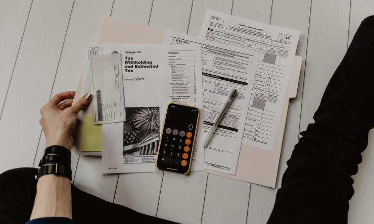 A person going over financial and tax documents.