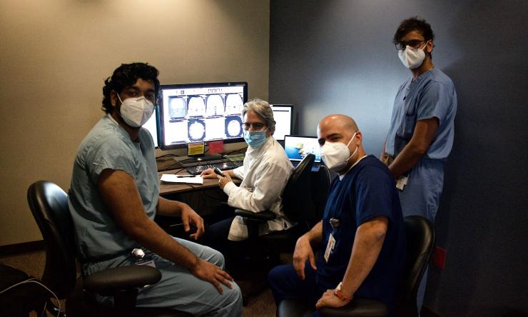 Residents and Faculty collaborating on a neuroradiology case at Ben Taub.