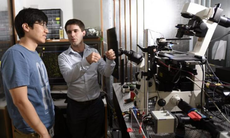 Graduate student Jihwan (James) Lee (left) and Dr. François St-Pierre in the lab.