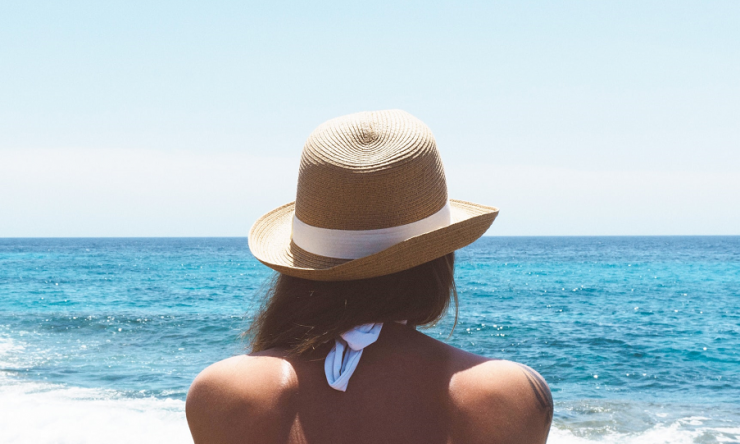 Woman in hat, sun protection