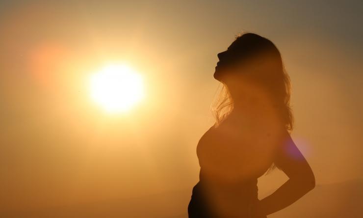 Silhouette of pregnant woman in sun