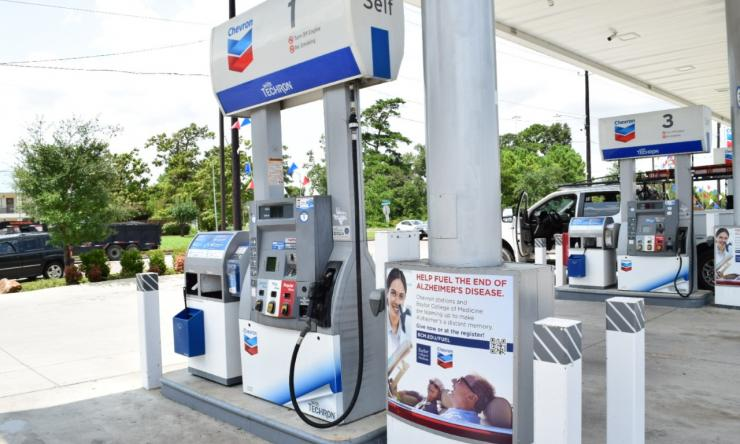 Chevron gas stations with signage of BCM Alzheimer's fundraising campaign