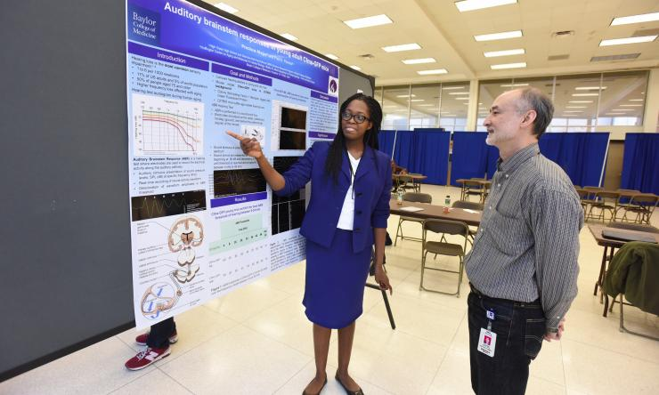 Summer Research student Precious Akujor reviews details of her research work with Dr. Frederick Periera