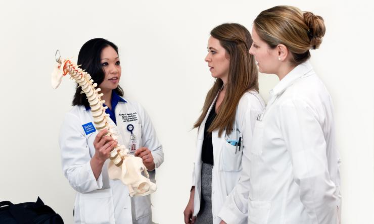 Dr. Rosalyn Nguyen instructing medical student Katherine Calaway and Resident Dr. Erika Moody.