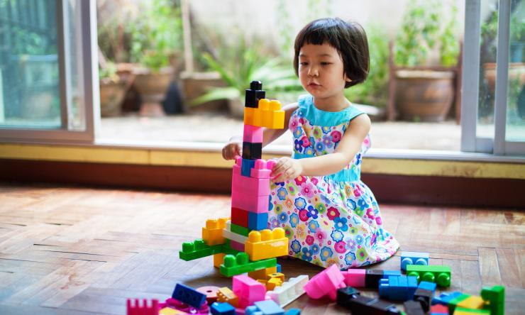 Young girl playing with legos, for SPARK research recruitment