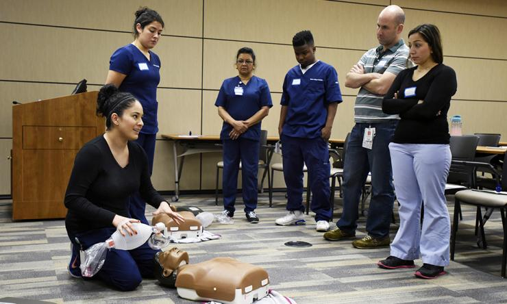 A Baylor College of Medicine community nurse providing CPR training.