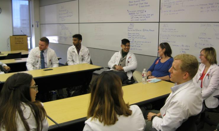 Students debrief with Dr. Hatfield after an interprofessional educational experience.