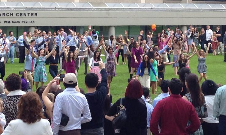 """Members from the Class of 2014 dance to Pharrell Williams """"Happy"""" in a surprise dance mob."""