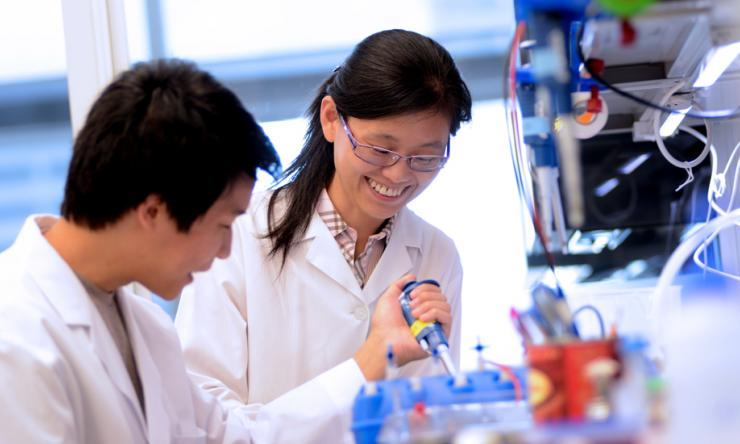 Two researchers working in the lab.