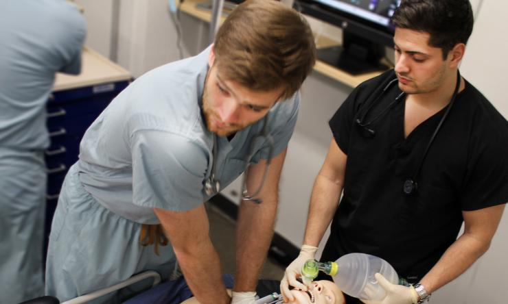 Members of Baylor's Simlympic Team resuscitate Sim Man in the college's Simulation Center